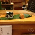 Vegan sushi: kampyo maki on the left, and inari sushi on the right