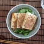 Tofu topped with ground sesame and shoyu on rice